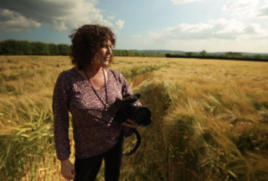 Award winning filmmaker Patty Greer in a 2014 Crop Circle, Dorset England UK