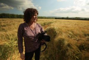 Award winning filmmaker Patty Greer in a 2014 Crop Circle, Dorset England UK