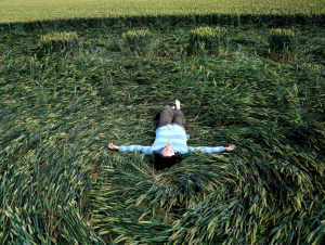 Filmmaker Patty Greer laying in a UK Crop Circle - Wiltshire England 2010