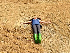 Filmmaker Patty Greer laying in a UK Crop Circle - Wiltshire England 2008